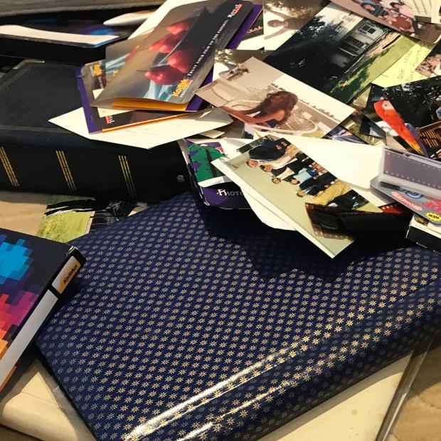 Physical Photo and Memorabilia Organizing-pile of photo albums, physical photos, negatives, photo envelopes