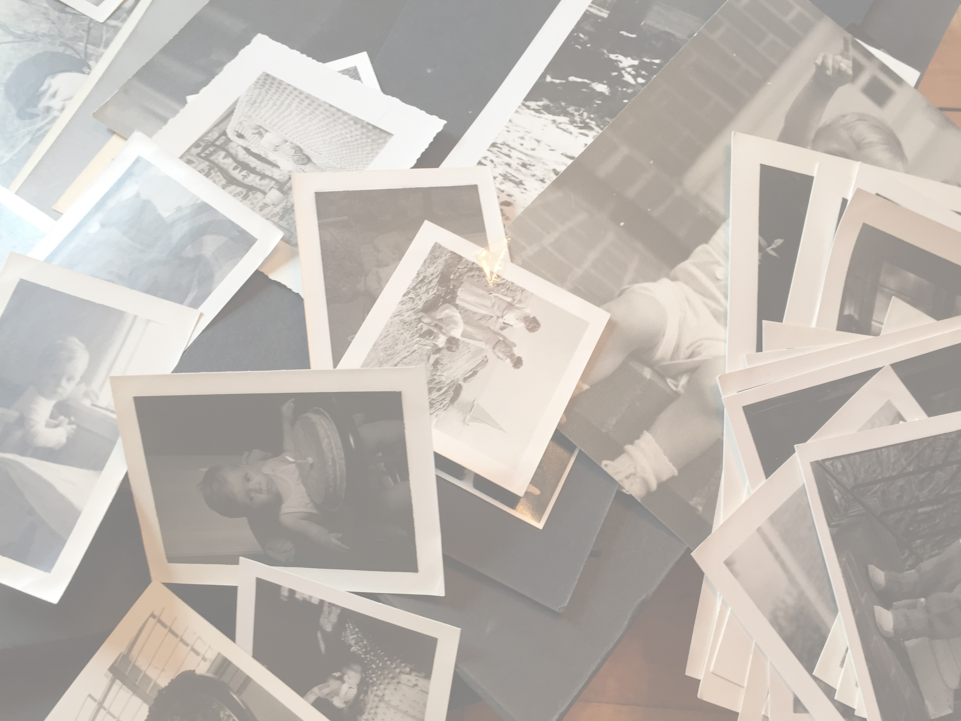 vintage photographs tossed on a table with filter